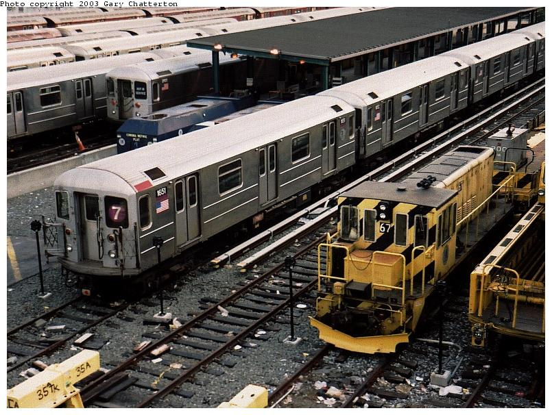 (122k, 805x606)<br><b>Country:</b> United States<br><b>City:</b> New York<br><b>System:</b> New York City Transit<br><b>Location:</b> Corona Yard<br><b>Car:</b> R-62A (Bombardier, 1984-1987)  1651 <br><b>Photo by:</b> Gary Chatterton<br><b>Date:</b> 5/24/2003<br><b>Notes:</b> With Loco 67<br><b>Viewed (this week/total):</b> 0 / 3276