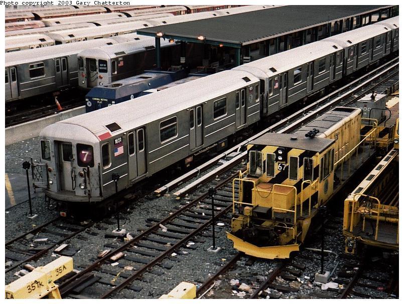(122k, 805x606)<br><b>Country:</b> United States<br><b>City:</b> New York<br><b>System:</b> New York City Transit<br><b>Location:</b> Corona Yard<br><b>Car:</b> R-62A (Bombardier, 1984-1987)  1651 <br><b>Photo by:</b> Gary Chatterton<br><b>Date:</b> 5/24/2003<br><b>Notes:</b> With Loco 67<br><b>Viewed (this week/total):</b> 5 / 3181