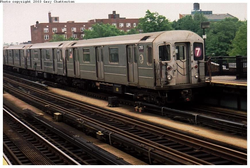 (93k, 870x586)<br><b>Country:</b> United States<br><b>City:</b> New York<br><b>System:</b> New York City Transit<br><b>Line:</b> IRT Flushing Line<br><b>Location:</b> 69th Street/Fisk Avenue <br><b>Route:</b> 7<br><b>Car:</b> R-62A (Bombardier, 1984-1987)  2155 <br><b>Photo by:</b> Gary Chatterton<br><b>Date:</b> 5/24/2003<br><b>Viewed (this week/total):</b> 1 / 2994