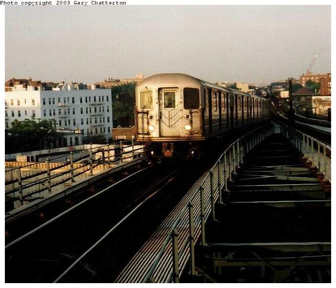 (63k, 690x591)<br><b>Country:</b> United States<br><b>City:</b> New York<br><b>System:</b> New York City Transit<br><b>Line:</b> IRT Flushing Line<br><b>Location:</b> 61st Street/Woodside <br><b>Route:</b> 7<br><b>Car:</b> R-62A (Bombardier, 1984-1987)  2077 <br><b>Photo by:</b> Gary Chatterton<br><b>Date:</b> 6/4/2003<br><b>Viewed (this week/total):</b> 2 / 3667
