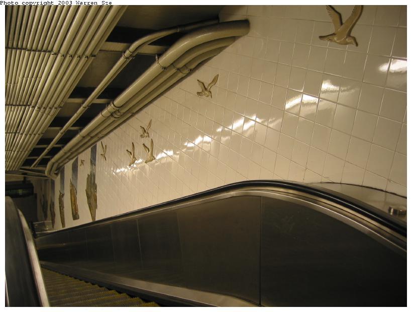 (63k, 820x620)<br><b>Country:</b> United States<br><b>City:</b> New York<br><b>System:</b> New York City Transit<br><b>Line:</b> BMT Broadway Line<br><b>Location:</b> Whitehall Street <br><b>Photo by:</b> Warren Sze<br><b>Date:</b> 7/3/2003<br><b>Artwork:</b> <i>Passages</i>, Frank Giorgini (2000).<br><b>Notes:</b> South exit<br><b>Viewed (this week/total):</b> 1 / 3534