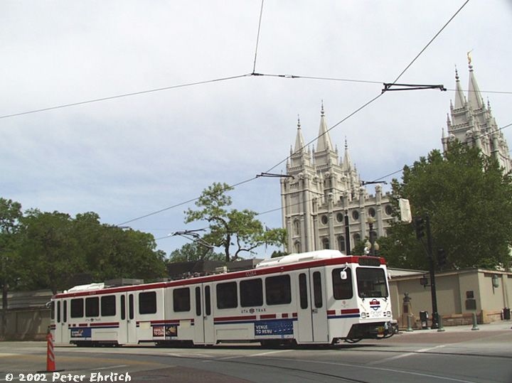 (62k, 720x539)<br><b>Country:</b> United States<br><b>City:</b> Salt Lake City, UT<br><b>System:</b> TRAX<br><b>Location:</b> South Temple & Main <br><b>Car:</b>  102 <br><b>Photo by:</b> Peter Ehrlich<br><b>Date:</b> 6/8/2002<br><b>Notes:</b> Car 102; the famous Mormon Temple is in the background.<br><b>Viewed (this week/total):</b> 3 / 5424
