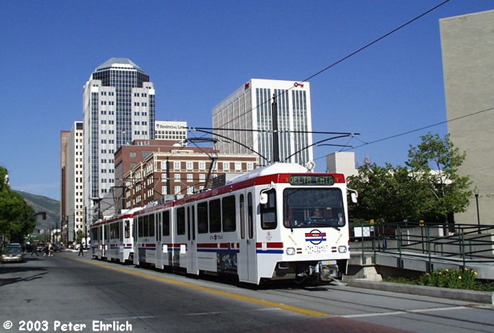 (73k, 720x486)<br><b>Country:</b> United States<br><b>City:</b> Salt Lake City, UT<br><b>System:</b> TRAX<br><b>Location:</b> Delta Center (301 W. & S. Temple) <br><b>Car:</b>  1033/1031 <br><b>Photo by:</b> Peter Ehrlich<br><b>Date:</b> 6/8/2002<br><b>Notes:</b> Inbound train of SD160s LRVs (1033/1031) at Temple Square Station.<br><b>Viewed (this week/total):</b> 3 / 6824