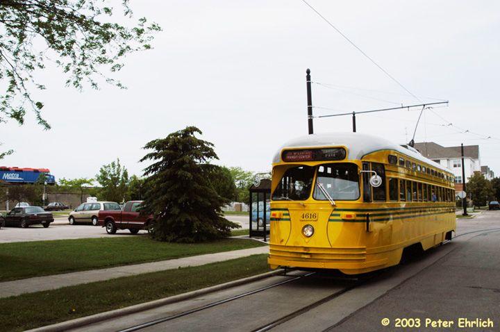 (64k, 720x478)<br><b>Country:</b> United States<br><b>City:</b> Kenosha, WI<br><b>System:</b> Kenosha Electric Railway<br><b>Location:</b> 54th St. & 11th Ave. (West to South Turn) <br><b>Car:</b> PCC (TTC Toronto) 4616 <br><b>Photo by:</b> Peter Ehrlich<br><b>Date:</b> 6/14/2003<br><b>Notes:</b> With Metra commuter train on the old C&NW line.<br><b>Viewed (this week/total):</b> 0 / 2978