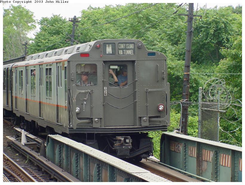 (117k, 820x620)<br><b>Country:</b> United States<br><b>City:</b> New York<br><b>System:</b> New York City Transit<br><b>Line:</b> BMT Myrtle Avenue Line<br><b>Location:</b> Metropolitan Avenue <br><b>Route:</b> Fan Trip<br><b>Car:</b> R-7A (Pullman, 1938)  1575 <br><b>Photo by:</b> John Miller<br><b>Date:</b> 6/28/2003<br><b>Viewed (this week/total):</b> 1 / 3960