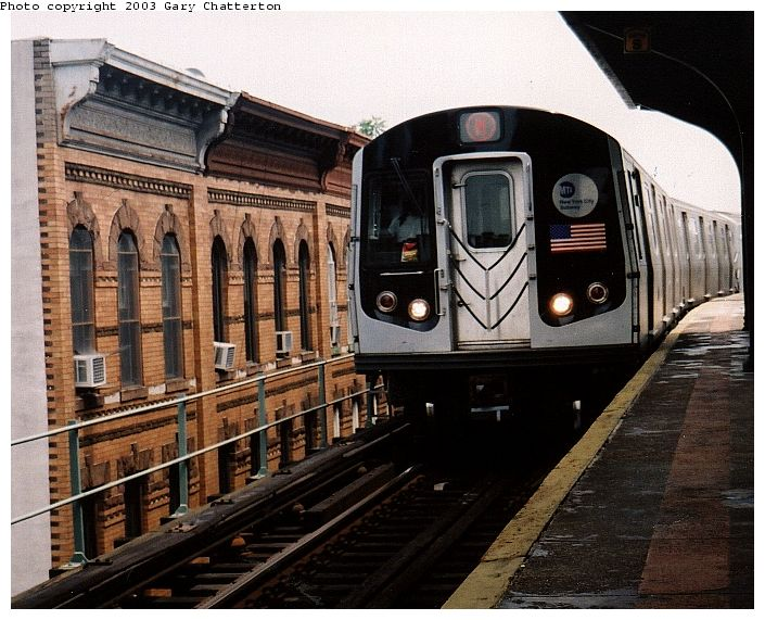 (92k, 705x571)<br><b>Country:</b> United States<br><b>City:</b> New York<br><b>System:</b> New York City Transit<br><b>Line:</b> BMT Myrtle Avenue Line<br><b>Location:</b> Seneca Avenue <br><b>Route:</b> M<br><b>Car:</b> R-143 (Kawasaki, 2001-2002) 8137 <br><b>Photo by:</b> Gary Chatterton<br><b>Date:</b> 6/28/2003<br><b>Viewed (this week/total):</b> 1 / 5383