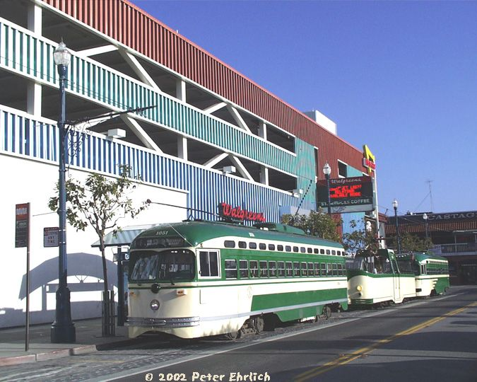 (85k, 675x540)<br><b>Country:</b> United States<br><b>City:</b> San Francisco/Bay Area, CA<br><b>System:</b> SF MUNI<br><b>Location:</b> Jones/Beach <br><b>Car:</b> SF MUNI PCC (Ex-SEPTA) (St. Louis Car Co., 1947-1948)  1051 <br><b>Photo by:</b> Peter Ehrlich<br><b>Date:</b> 6/7/2002<br><b>Notes:</b> With Blackpool Boat Tram #228 and PCC 1050. Photo is named Sky of Blue, Sea of Green (and Cream)!<br><b>Viewed (this week/total):</b> 0 / 1011