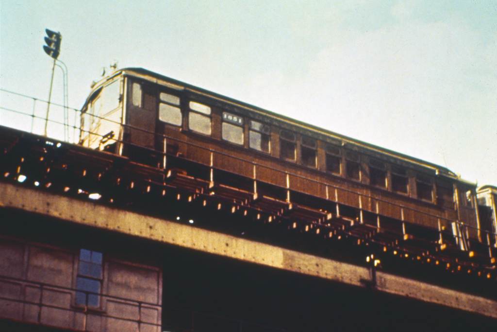 (320k, 1024x683)<br><b>Country:</b> United States<br><b>City:</b> New York<br><b>System:</b> New York City Transit<br><b>Line:</b> 3rd Avenue El<br><b>Location:</b> Chatham Square <br><b>Car:</b> MUDC 1651 <br><b>Photo by:</b> Joseph Frank<br><b>Collection of:</b> David Pirmann<br><b>Date:</b> 3/7/1955<br><b>Notes:</b> Train on southbound track seen from street<br><b>Viewed (this week/total):</b> 0 / 6932