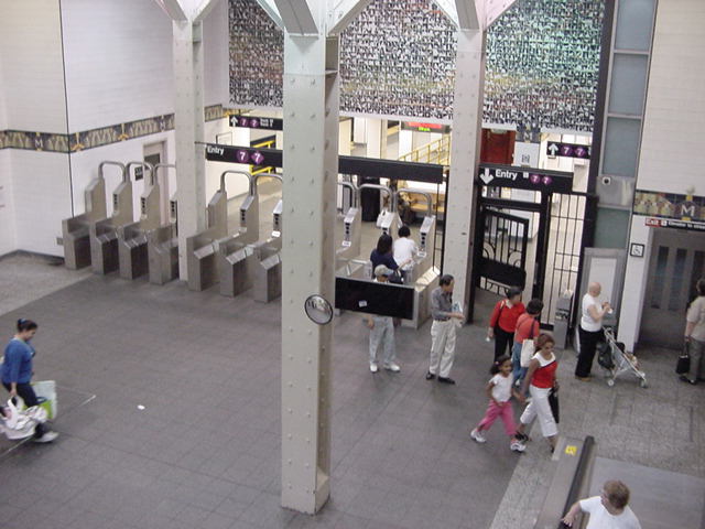 (61k, 640x480)<br><b>Country:</b> United States<br><b>City:</b> New York<br><b>System:</b> New York City Transit<br><b>Line:</b> IRT Flushing Line<br><b>Location:</b> Main Street/Flushing <br><b>Photo by:</b> Salaam Allah<br><b>Date:</b> 9/21/2002<br><b>Artwork:</b> <i>Happy World</i>, Ik-Joong Kang (1998).<br><b>Viewed (this week/total):</b> 0 / 8355