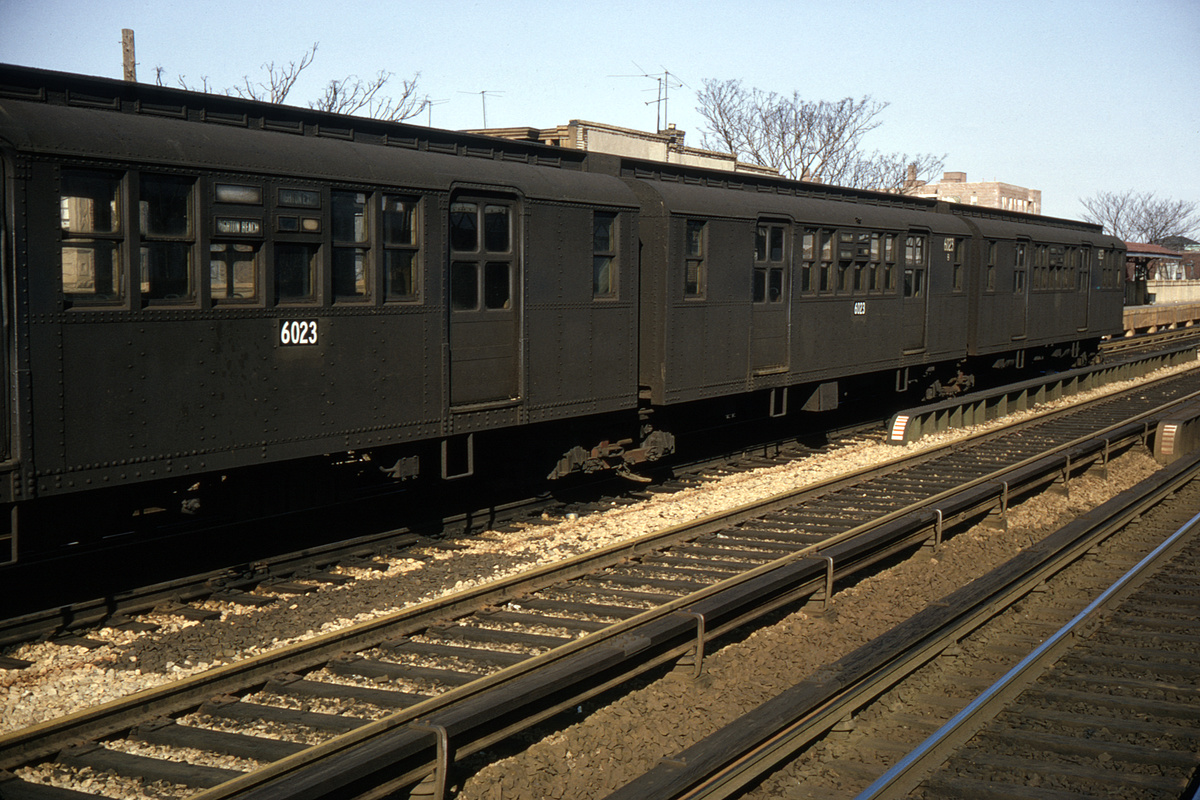 (472k, 1044x709)<br><b>Country:</b> United States<br><b>City:</b> New York<br><b>System:</b> New York City Transit<br><b>Line:</b> BMT Brighton Line<br><b>Location:</b> Neck Road <br><b>Car:</b> BMT D-Type Triplex 6023 <br><b>Collection of:</b> David Pirmann<br><b>Date:</b> 2/9/1964<br><b>Notes:</b> Paper numbers under side windows were an experiment; applied to D types 6023, 6076, 6077, and 6097; also was tried on five R1-9 types from Concourse at their door pockets, and ten R-10 class cars.<br><b>Viewed (this week/total):</b> 0 / 3618