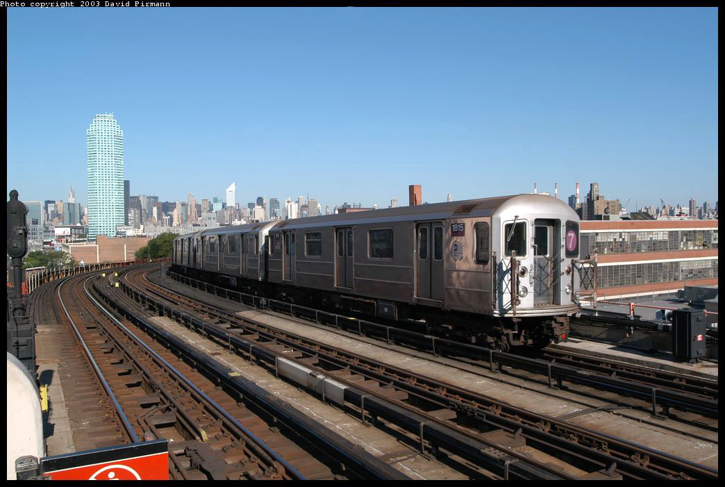(207k, 1044x701)<br><b>Country:</b> United States<br><b>City:</b> New York<br><b>System:</b> New York City Transit<br><b>Line:</b> IRT Flushing Line<br><b>Location:</b> 33rd Street/Rawson Street <br><b>Route:</b> 7<br><b>Car:</b> R-62A (Bombardier, 1984-1987)  1815 <br><b>Photo by:</b> David Pirmann<br><b>Date:</b> 8/23/2003<br><b>Viewed (this week/total):</b> 4 / 3430