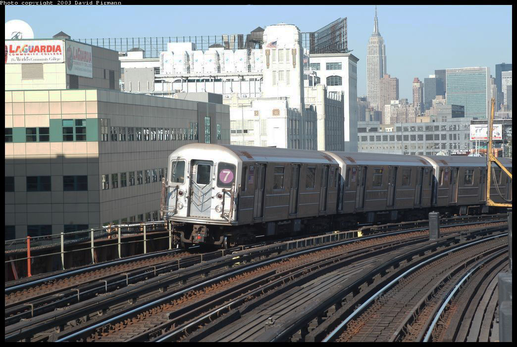 (234k, 1044x701)<br><b>Country:</b> United States<br><b>City:</b> New York<br><b>System:</b> New York City Transit<br><b>Line:</b> IRT Flushing Line<br><b>Location:</b> 33rd Street/Rawson Street <br><b>Route:</b> 7<br><b>Car:</b> R-62A (Bombardier, 1984-1987)  1815 <br><b>Photo by:</b> David Pirmann<br><b>Date:</b> 8/23/2003<br><b>Viewed (this week/total):</b> 0 / 2592