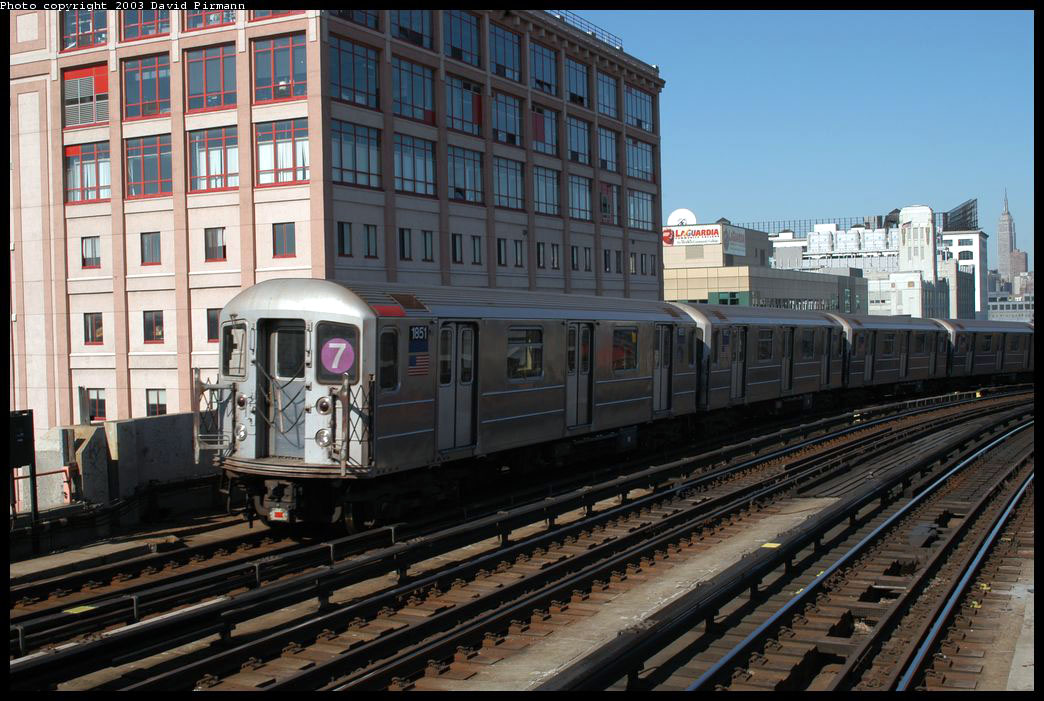 (226k, 1044x701)<br><b>Country:</b> United States<br><b>City:</b> New York<br><b>System:</b> New York City Transit<br><b>Line:</b> IRT Flushing Line<br><b>Location:</b> 33rd Street/Rawson Street <br><b>Route:</b> 7<br><b>Car:</b> R-62A (Bombardier, 1984-1987)  1851 <br><b>Photo by:</b> David Pirmann<br><b>Date:</b> 8/23/2003<br><b>Viewed (this week/total):</b> 2 / 2800