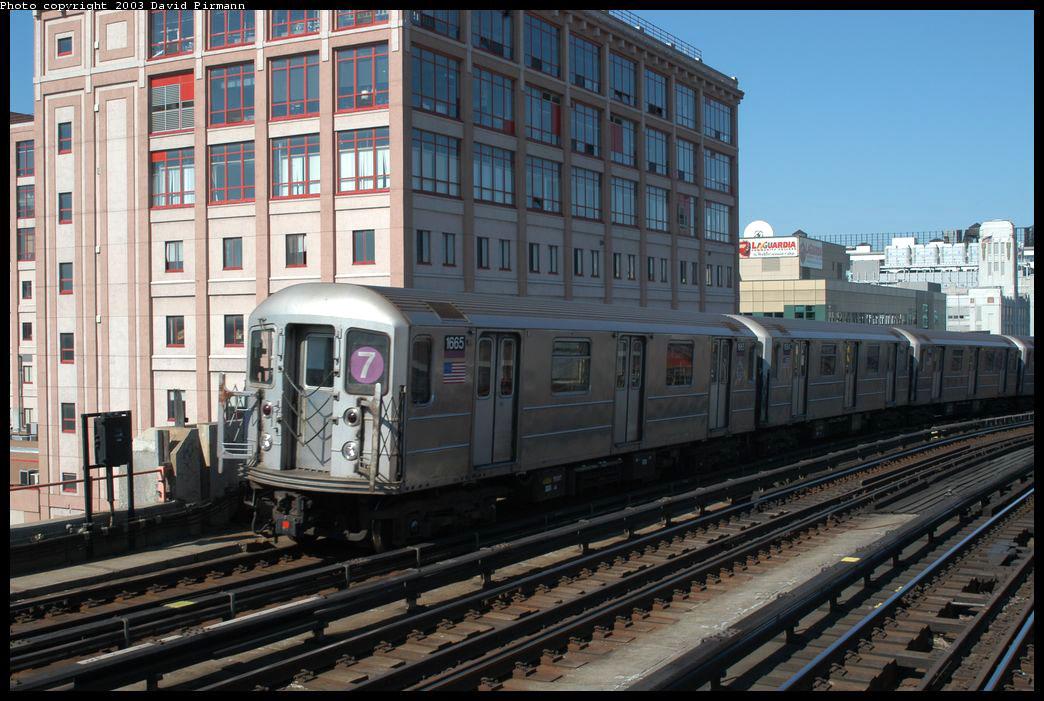 (226k, 1044x701)<br><b>Country:</b> United States<br><b>City:</b> New York<br><b>System:</b> New York City Transit<br><b>Line:</b> IRT Flushing Line<br><b>Location:</b> 33rd Street/Rawson Street <br><b>Route:</b> 7<br><b>Car:</b> R-62A (Bombardier, 1984-1987)  1665 <br><b>Photo by:</b> David Pirmann<br><b>Date:</b> 8/23/2003<br><b>Viewed (this week/total):</b> 0 / 5683