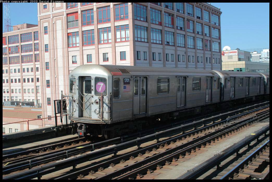 (231k, 1044x701)<br><b>Country:</b> United States<br><b>City:</b> New York<br><b>System:</b> New York City Transit<br><b>Line:</b> IRT Flushing Line<br><b>Location:</b> 33rd Street/Rawson Street <br><b>Route:</b> 7<br><b>Car:</b> R-62A (Bombardier, 1984-1987)  1701 <br><b>Photo by:</b> David Pirmann<br><b>Date:</b> 8/23/2003<br><b>Viewed (this week/total):</b> 0 / 2677