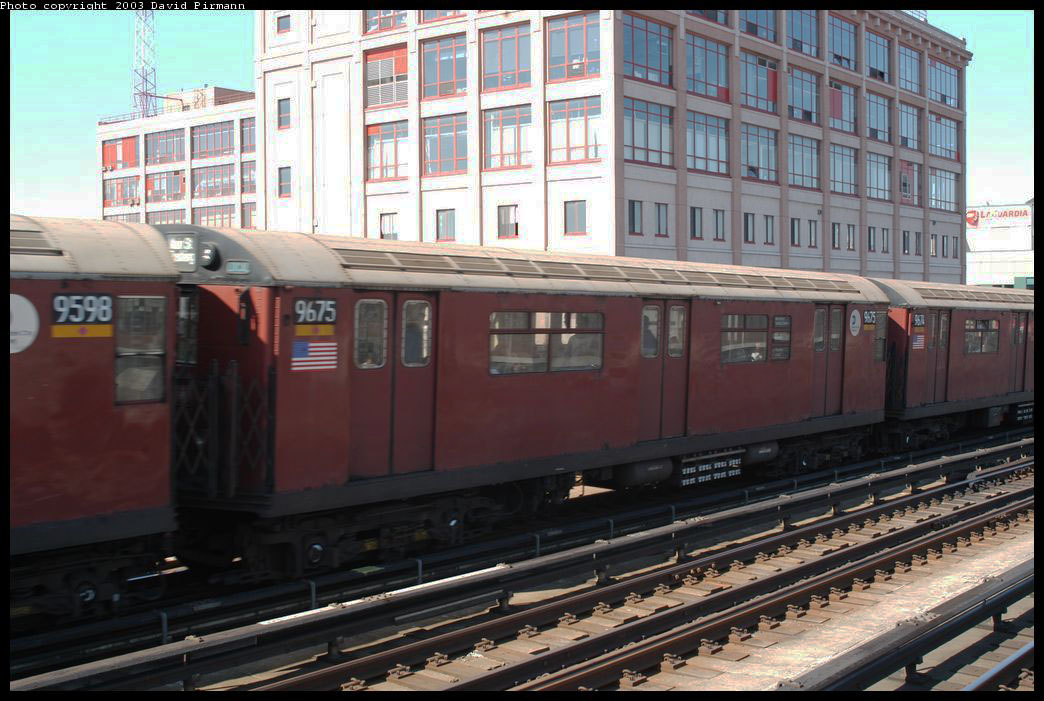 (214k, 1044x701)<br><b>Country:</b> United States<br><b>City:</b> New York<br><b>System:</b> New York City Transit<br><b>Line:</b> IRT Flushing Line<br><b>Location:</b> 33rd Street/Rawson Street <br><b>Route:</b> 7<br><b>Car:</b> R-36 World's Fair (St. Louis, 1963-64) 9675 <br><b>Photo by:</b> David Pirmann<br><b>Date:</b> 8/23/2003<br><b>Viewed (this week/total):</b> 1 / 2494