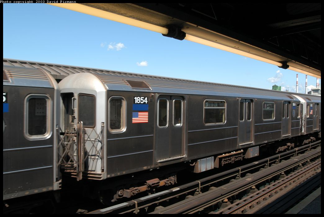 (154k, 1044x701)<br><b>Country:</b> United States<br><b>City:</b> New York<br><b>System:</b> New York City Transit<br><b>Line:</b> IRT Flushing Line<br><b>Location:</b> Court House Square/45th Road <br><b>Route:</b> 7<br><b>Car:</b> R-62A (Bombardier, 1984-1987)  1854 <br><b>Photo by:</b> David Pirmann<br><b>Date:</b> 8/23/2003<br><b>Viewed (this week/total):</b> 2 / 3046