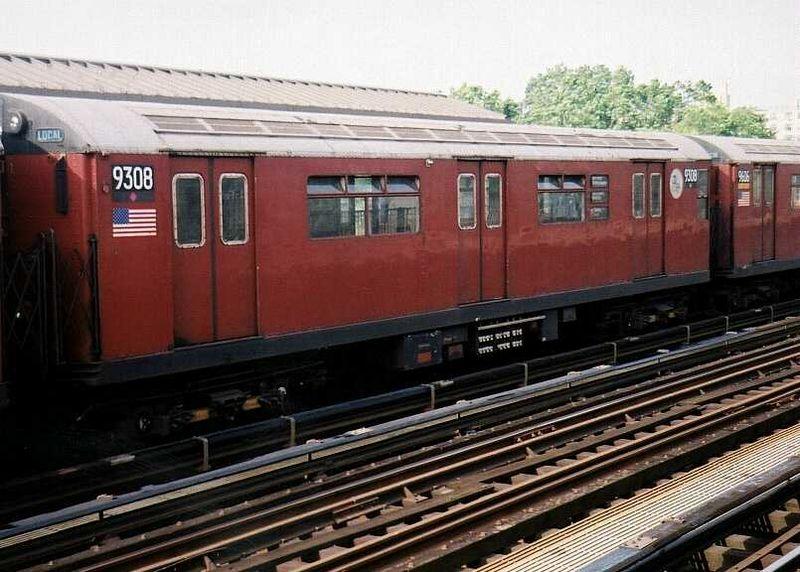 (92k, 800x572)<br><b>Country:</b> United States<br><b>City:</b> New York<br><b>System:</b> New York City Transit<br><b>Line:</b> IRT Flushing Line<br><b>Location:</b> 69th Street/Fisk Avenue <br><b>Route:</b> 7<br><b>Car:</b> R-33 World's Fair (St. Louis, 1963-64) 9308 <br><b>Photo by:</b> Gary Chatterton<br><b>Date:</b> 7/1/2003<br><b>Viewed (this week/total):</b> 0 / 4269
