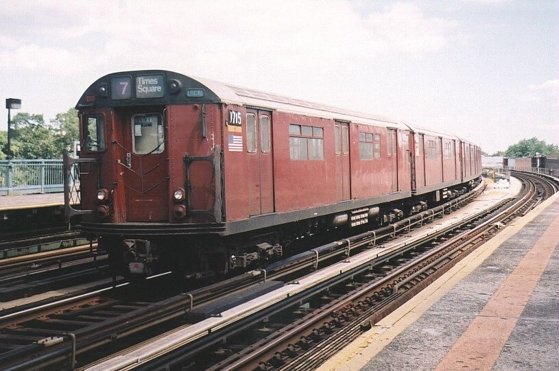 (95k, 815x541)<br><b>Country:</b> United States<br><b>City:</b> New York<br><b>System:</b> New York City Transit<br><b>Line:</b> IRT Flushing Line<br><b>Location:</b> 103rd Street/Corona Plaza <br><b>Route:</b> 7<br><b>Car:</b> R-36 World's Fair (St. Louis, 1963-64) 9715 <br><b>Photo by:</b> Gary Chatterton<br><b>Date:</b> 8/23/2003<br><b>Viewed (this week/total):</b> 1 / 4081