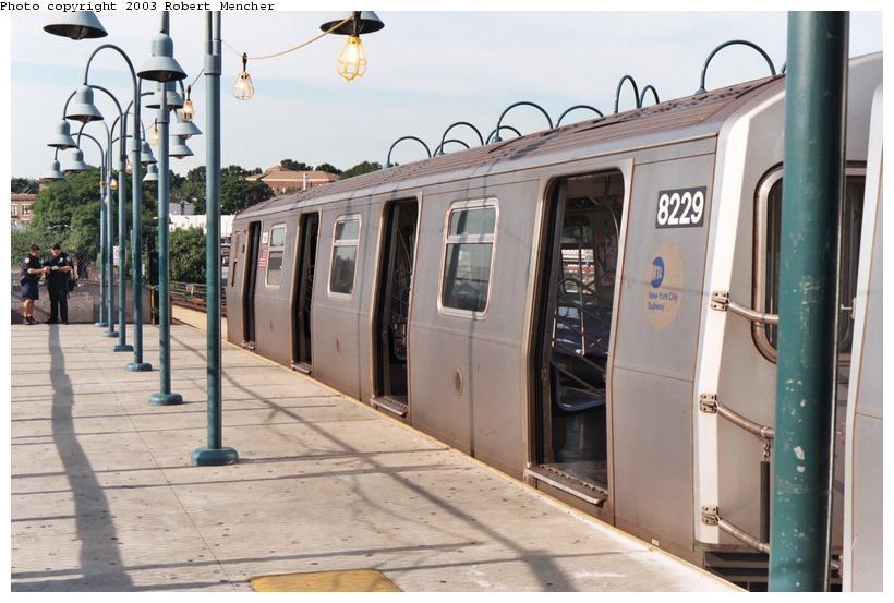 (99k, 820x553)<br><b>Country:</b> United States<br><b>City:</b> New York<br><b>System:</b> New York City Transit<br><b>Line:</b> BMT Canarsie Line<br><b>Location:</b> Broadway Junction <br><b>Route:</b> L<br><b>Car:</b> R-143 (Kawasaki, 2001-2002) 8229 <br><b>Photo by:</b> Robert Mencher<br><b>Date:</b> 9/2003<br><b>Viewed (this week/total):</b> 0 / 4249