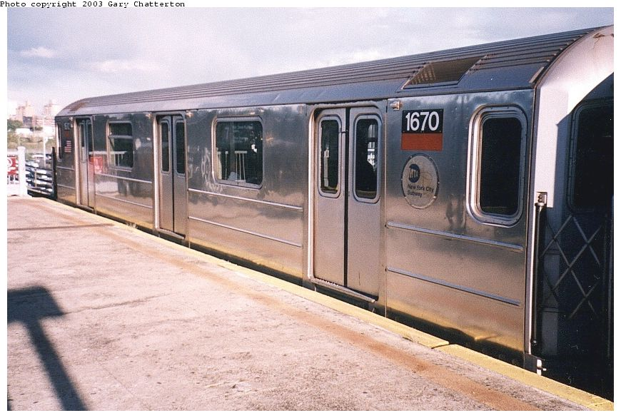 (103k, 870x586)<br><b>Country:</b> United States<br><b>City:</b> New York<br><b>System:</b> New York City Transit<br><b>Line:</b> IRT Flushing Line<br><b>Location:</b> Willets Point/Mets (fmr. Shea Stadium) <br><b>Route:</b> 7<br><b>Car:</b> R-62A (Bombardier, 1984-1987)  1670 <br><b>Photo by:</b> Gary Chatterton<br><b>Date:</b> 10/2/2003<br><b>Viewed (this week/total):</b> 0 / 2896