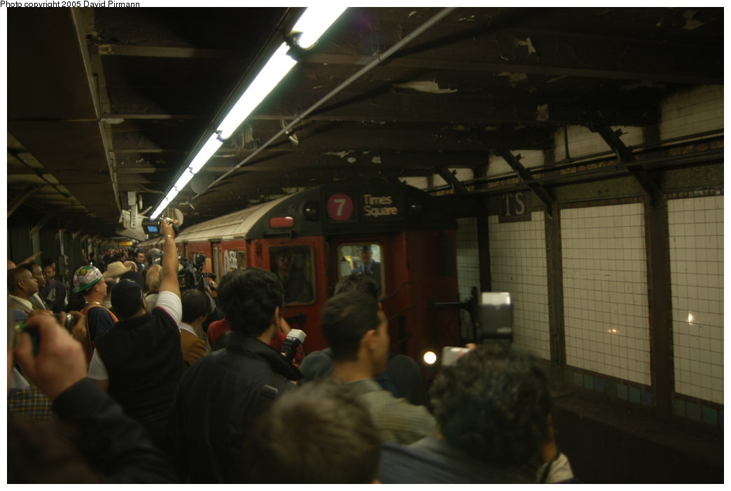 (135k, 1044x701)<br><b>Country:</b> United States<br><b>City:</b> New York<br><b>System:</b> New York City Transit<br><b>Line:</b> IRT Flushing Line<br><b>Location:</b> Times Square <br><b>Route:</b> 7<br><b>Car:</b> R-36 World's Fair (St. Louis, 1963-64) 9584 <br><b>Photo by:</b> David Pirmann<br><b>Date:</b> 11/3/2003<br><b>Notes:</b> The last revenue redbird train enters Times Square amid railfan (and media) frenzy just prior to the final trip to Willets Pt.<br><b>Viewed (this week/total):</b> 0 / 7138