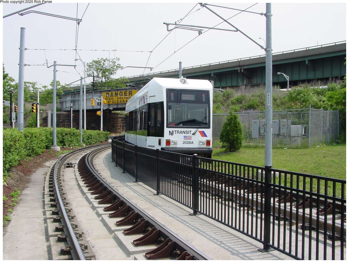 (103k, 820x620)<br><b>Country:</b> United States<br><b>City:</b> Jersey City, NJ<br><b>System:</b> Hudson Bergen Light Rail<br><b>Location:</b> Liberty State Park <br><b>Car:</b> NJT-HBLR LRV (Kinki-Sharyo, 1998-99)  2028 <br><b>Photo by:</b> Richard Panse<br><b>Date:</b> 6/5/2002<br><b>Viewed (this week/total):</b> 1 / 3404