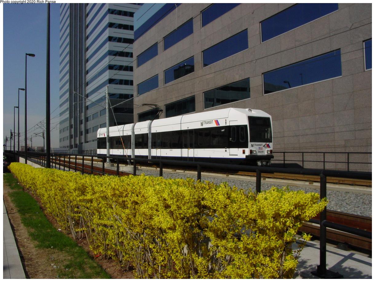 (87k, 768x576)<br><b>Country:</b> United States<br><b>City:</b> Jersey City, NJ<br><b>System:</b> Hudson Bergen Light Rail<br><b>Location:</b> Pavonia/Newport <br><b>Car:</b> NJT-HBLR LRV (Kinki-Sharyo, 1998-99)   <br><b>Photo by:</b> Richard Panse<br><b>Date:</b> 2003<br><b>Notes:</b> At bottom of overpass just about to enter Newport station<br><b>Viewed (this week/total):</b> 2 / 2997