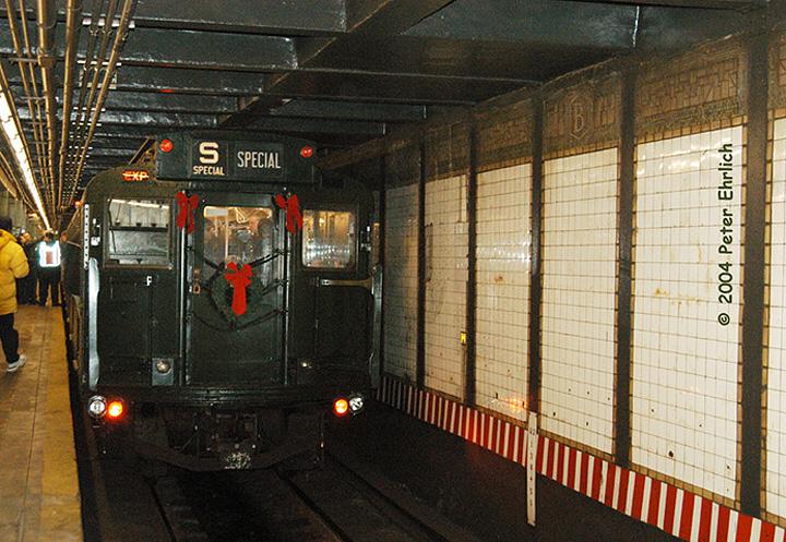 (221k, 720x497)<br><b>Country:</b> United States<br><b>City:</b> New York<br><b>System:</b> New York City Transit<br><b>Line:</b> BMT Canarsie Line<br><b>Location:</b> Bedford Avenue <br><b>Route:</b> Fan Trip<br><b>Car:</b> R-1 (American Car & Foundry, 1930-1931) 100 <br><b>Photo by:</b> Peter Ehrlich<br><b>Date:</b> 12/28/2003<br><b>Viewed (this week/total):</b> 0 / 4473