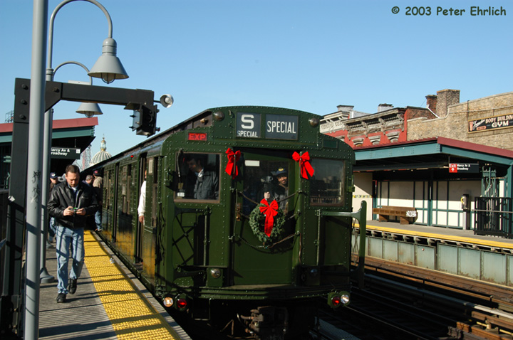 (149k, 720x478)<br><b>Country:</b> United States<br><b>City:</b> New York<br><b>System:</b> New York City Transit<br><b>Line:</b> BMT Nassau Street/Jamaica Line<br><b>Location:</b> Marcy Avenue <br><b>Route:</b> Fan Trip<br><b>Car:</b> R-1 (American Car & Foundry, 1930-1931) 100 <br><b>Photo by:</b> Peter Ehrlich<br><b>Date:</b> 12/28/2003<br><b>Viewed (this week/total):</b> 0 / 3846