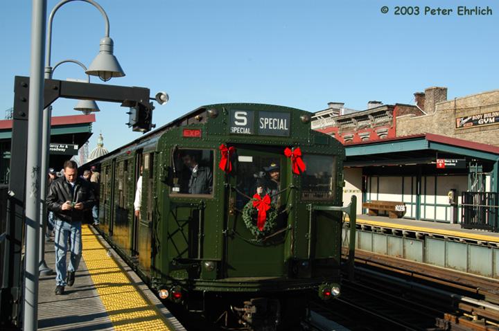 (149k, 720x478)<br><b>Country:</b> United States<br><b>City:</b> New York<br><b>System:</b> New York City Transit<br><b>Line:</b> BMT Nassau Street/Jamaica Line<br><b>Location:</b> Marcy Avenue <br><b>Route:</b> Fan Trip<br><b>Car:</b> R-1 (American Car & Foundry, 1930-1931) 100 <br><b>Photo by:</b> Peter Ehrlich<br><b>Date:</b> 12/28/2003<br><b>Viewed (this week/total):</b> 0 / 3862