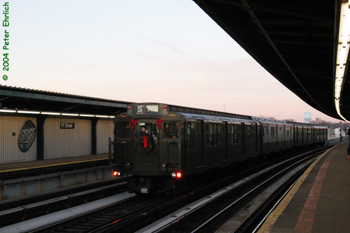 (101k, 720x478)<br><b>Country:</b> United States<br><b>City:</b> New York<br><b>System:</b> New York City Transit<br><b>Line:</b> BMT Nassau Street/Jamaica Line<br><b>Location:</b> 111th Street <br><b>Route:</b> Fan Trip<br><b>Car:</b> R-4 (American Car & Foundry, 1932-1933) 484 <br><b>Photo by:</b> Peter Ehrlich<br><b>Date:</b> 12/28/2003<br><b>Notes:</b> The artwork <i>Five Points of Observation</i> can be seen along the platform wall just to the left of the train.<br><b>Viewed (this week/total):</b> 0 / 3207