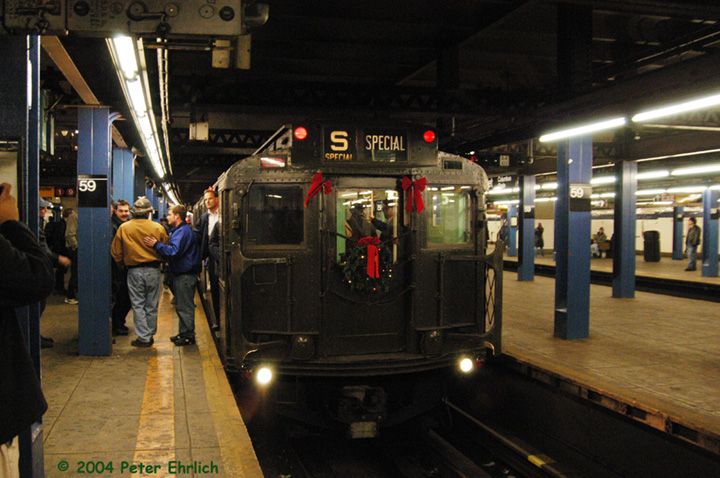 (161k, 720x478)<br><b>Country:</b> United States<br><b>City:</b> New York<br><b>System:</b> New York City Transit<br><b>Line:</b> IND 8th Avenue Line<br><b>Location:</b> 59th Street/Columbus Circle <br><b>Route:</b> Fan Trip<br><b>Car:</b> R-4 (American Car & Foundry, 1932-1933) 484 <br><b>Photo by:</b> Peter Ehrlich<br><b>Date:</b> 12/28/2003<br><b>Viewed (this week/total):</b> 0 / 3273