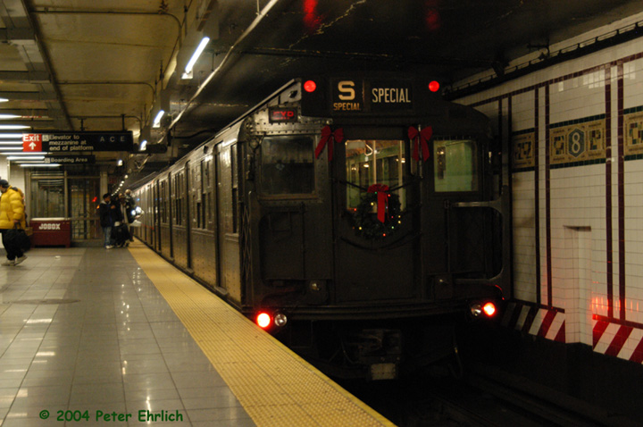(134k, 720x478)<br><b>Country:</b> United States<br><b>City:</b> New York<br><b>System:</b> New York City Transit<br><b>Line:</b> BMT Canarsie Line<br><b>Location:</b> 8th Avenue <br><b>Route:</b> Fan Trip<br><b>Car:</b> R-4 (American Car & Foundry, 1932-1933) 484 <br><b>Photo by:</b> Peter Ehrlich<br><b>Date:</b> 12/28/2003<br><b>Viewed (this week/total):</b> 1 / 2867