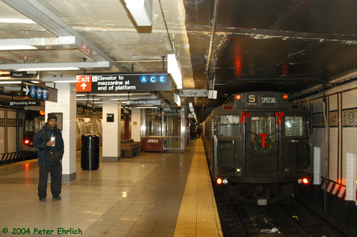 (154k, 720x478)<br><b>Country:</b> United States<br><b>City:</b> New York<br><b>System:</b> New York City Transit<br><b>Line:</b> BMT Canarsie Line<br><b>Location:</b> 8th Avenue <br><b>Route:</b> Fan Trip<br><b>Car:</b> R-4 (American Car & Foundry, 1932-1933) 484 <br><b>Photo by:</b> Peter Ehrlich<br><b>Date:</b> 12/28/2003<br><b>Viewed (this week/total):</b> 1 / 4545