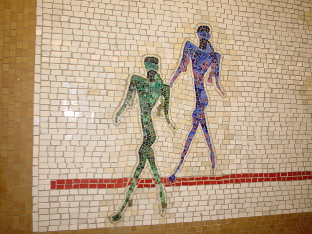 (152k, 640x480)<br><b>Country:</b> United States<br><b>City:</b> New York<br><b>System:</b> New York City Transit<br><b>Line:</b> IRT West Side Line<br><b>Location:</b> 66th Street/Lincoln Center <br><b>Photo by:</b> Kris Naudus<br><b>Date:</b> 1/25/2004<br><b>Artwork:</b> <i>Artemis, Acrobats, Divas and Dancers</i>, Nancy Spero (2004).<br><b>Notes:</b> Art installation, northbound platform.<br><b>Viewed (this week/total):</b> 0 / 3425