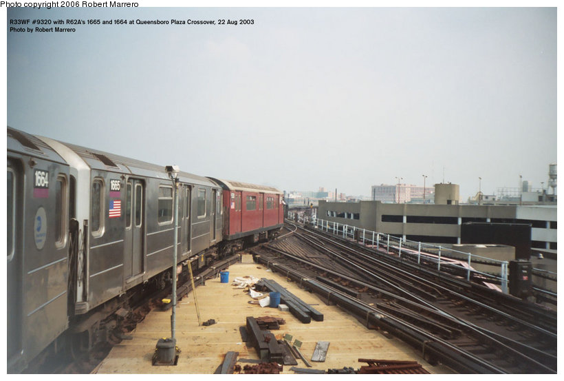 (89k, 820x553)<br><b>Country:</b> United States<br><b>City:</b> New York<br><b>System:</b> New York City Transit<br><b>Line:</b> IRT Flushing Line<br><b>Location:</b> Queensborough Plaza <br><b>Car:</b> R-33 World's Fair (St. Louis, 1963-64) 9320 <br><b>Photo by:</b> Robert Marrero<br><b>Date:</b> 8/2003<br><b>Notes:</b> With R62 1665-1664<br><b>Viewed (this week/total):</b> 3 / 4958