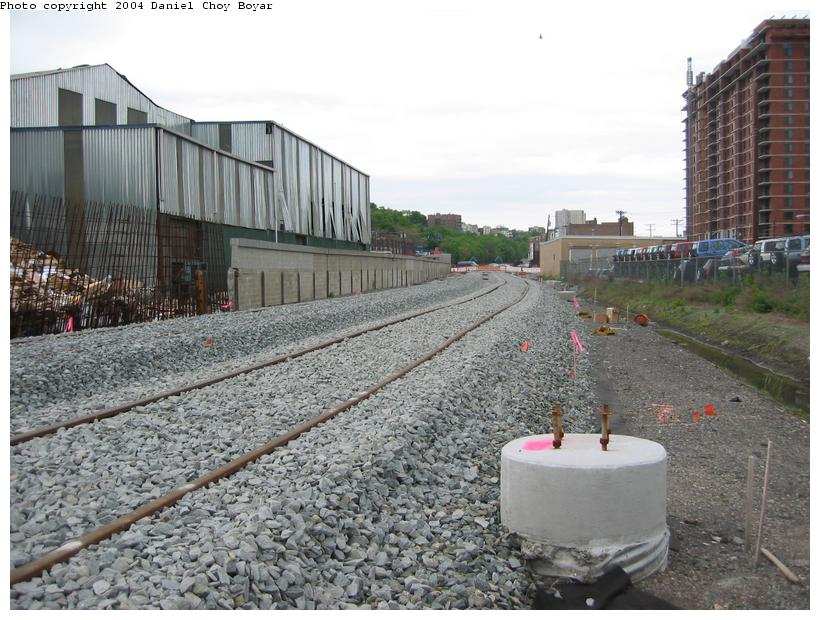 (106k, 820x620)<br><b>Country:</b> United States<br><b>City:</b> Hoboken, NJ<br><b>System:</b> Hudson Bergen Light Rail<br><b>Location:</b> Between Hoboken Wye and Paterson Ave. <br><b>Photo by:</b> Daniel C. Boyar<br><b>Date:</b> 5/16/2003<br><b>Notes:</b> New ROW and catenary tower bases (facing north from Observer Hwy)<br><b>Viewed (this week/total):</b> 0 / 2048