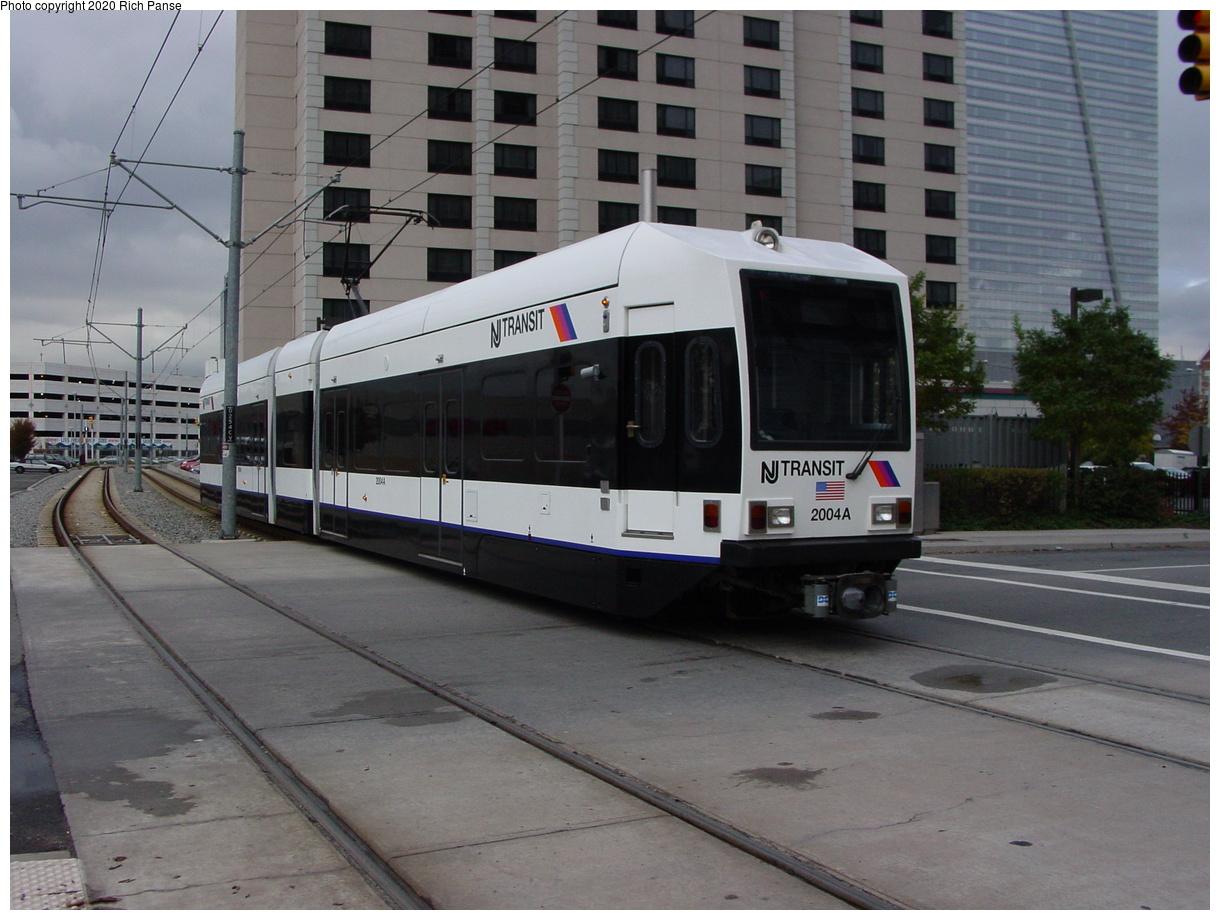 (73k, 820x620)<br><b>Country:</b> United States<br><b>City:</b> Jersey City, NJ<br><b>System:</b> Hudson Bergen Light Rail<br><b>Location:</b> Harsimus Cove <br><b>Car:</b> NJT-HBLR LRV (Kinki-Sharyo, 1998-99)  2004 <br><b>Photo by:</b> Richard Panse<br><b>Date:</b> 10/29/2003<br><b>Viewed (this week/total):</b> 3 / 2436
