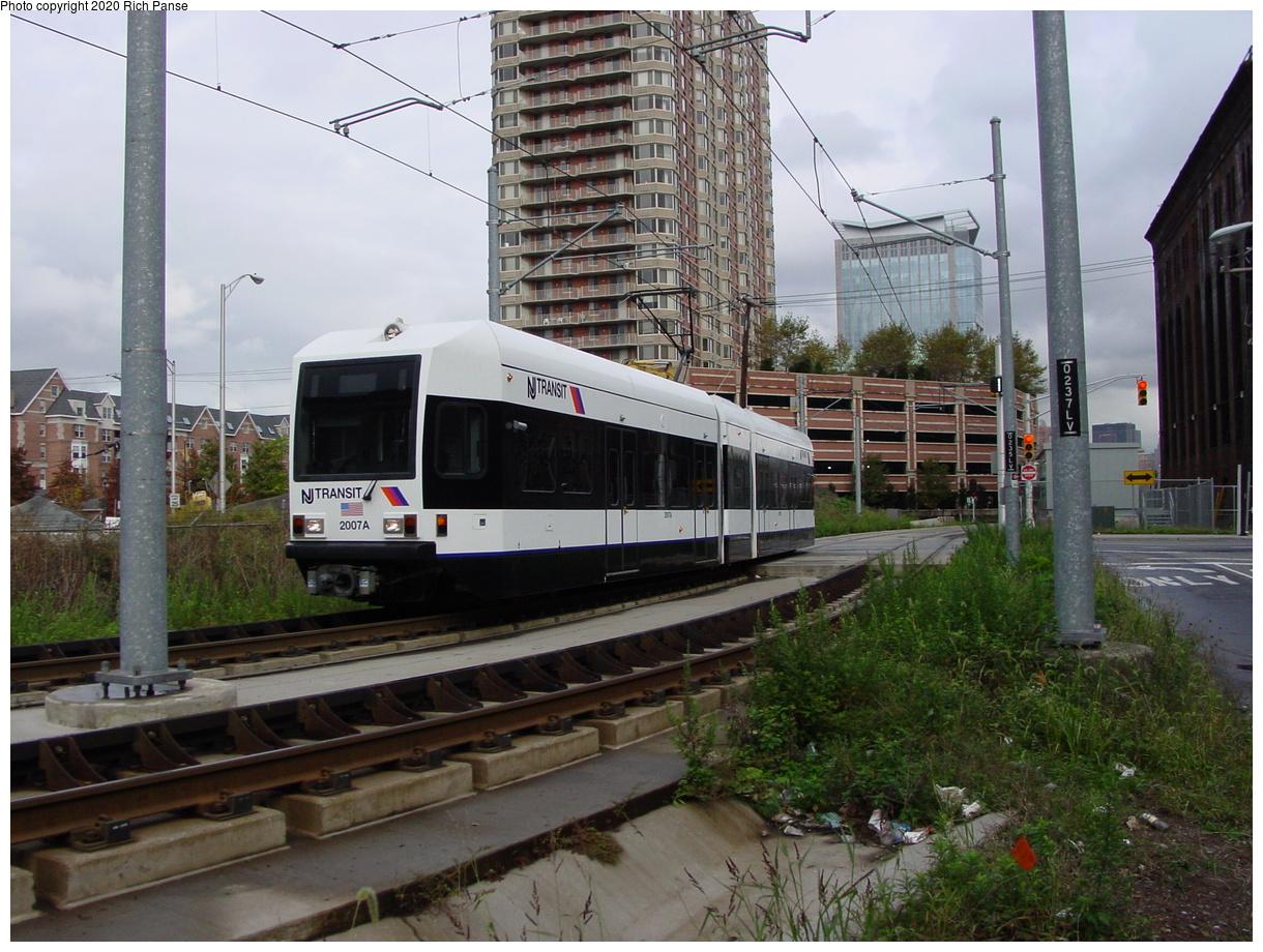 (92k, 820x620)<br><b>Country:</b> United States<br><b>City:</b> Jersey City, NJ<br><b>System:</b> Hudson Bergen Light Rail<br><b>Location:</b> Harsimus Cove <br><b>Car:</b> NJT-HBLR LRV (Kinki-Sharyo, 1998-99)  2007 <br><b>Photo by:</b> Richard Panse<br><b>Date:</b> 10/29/2003<br><b>Viewed (this week/total):</b> 1 / 2358