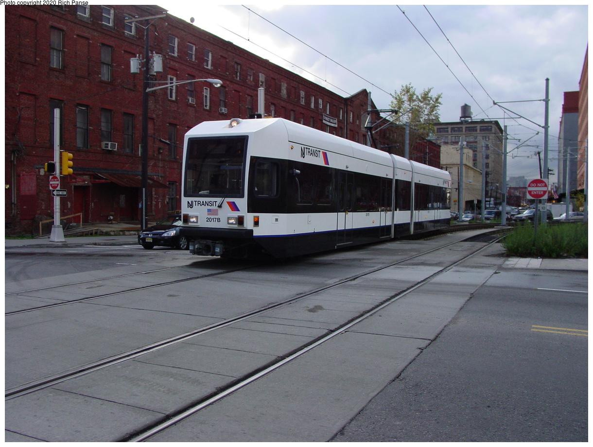 (75k, 820x620)<br><b>Country:</b> United States<br><b>City:</b> Jersey City, NJ<br><b>System:</b> Hudson Bergen Light Rail<br><b>Location:</b> Harsimus Cove <br><b>Car:</b> NJT-HBLR LRV (Kinki-Sharyo, 1998-99)  2017 <br><b>Photo by:</b> Richard Panse<br><b>Date:</b> 10/29/2003<br><b>Viewed (this week/total):</b> 0 / 2347