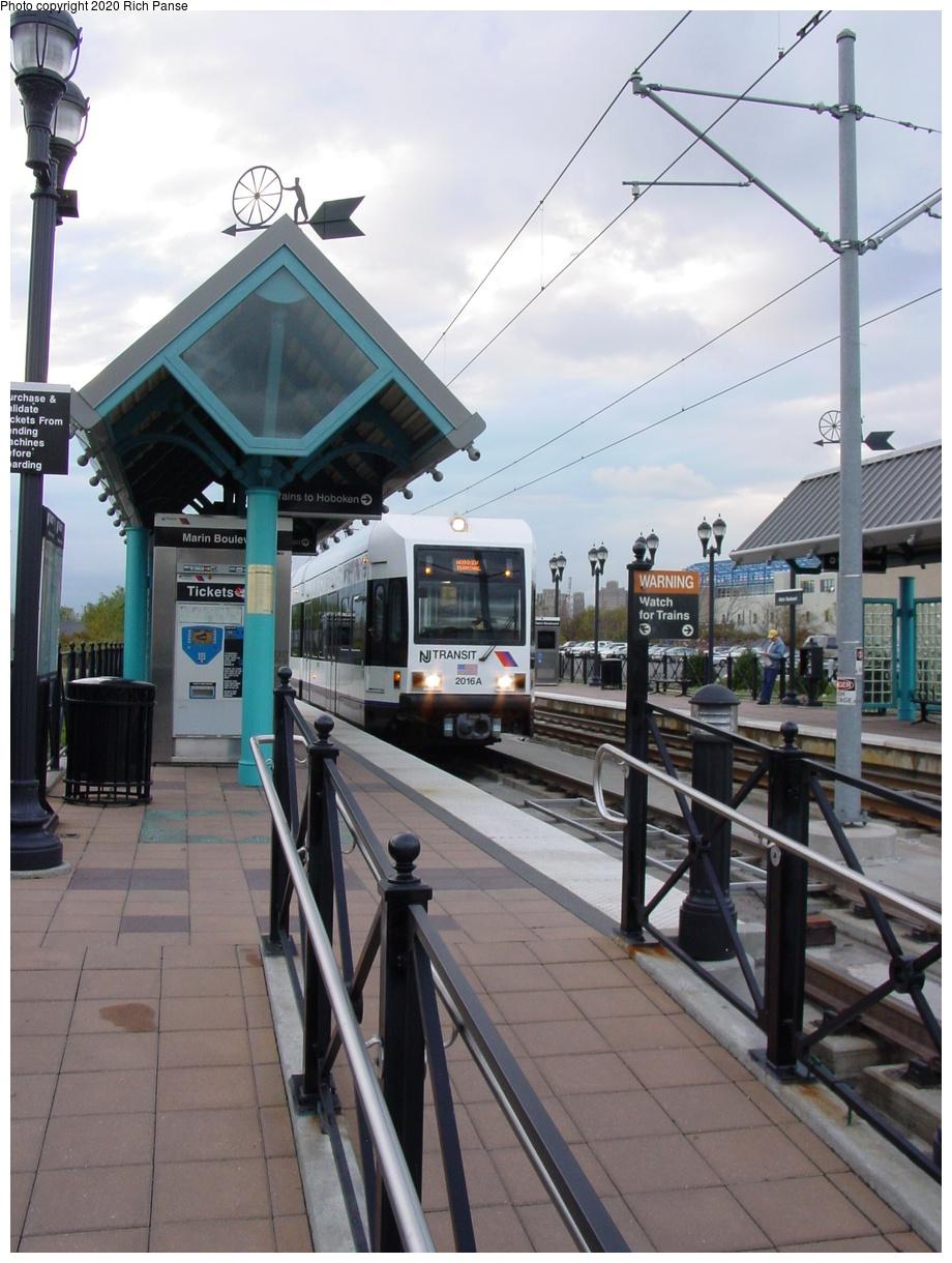 (81k, 622x823)<br><b>Country:</b> United States<br><b>City:</b> Jersey City, NJ<br><b>System:</b> Hudson Bergen Light Rail<br><b>Location:</b> Marin Boulevard <br><b>Car:</b> NJT-HBLR LRV (Kinki-Sharyo, 1998-99)  2016 <br><b>Photo by:</b> Richard Panse<br><b>Date:</b> 10/29/2003<br><b>Viewed (this week/total):</b> 1 / 2486