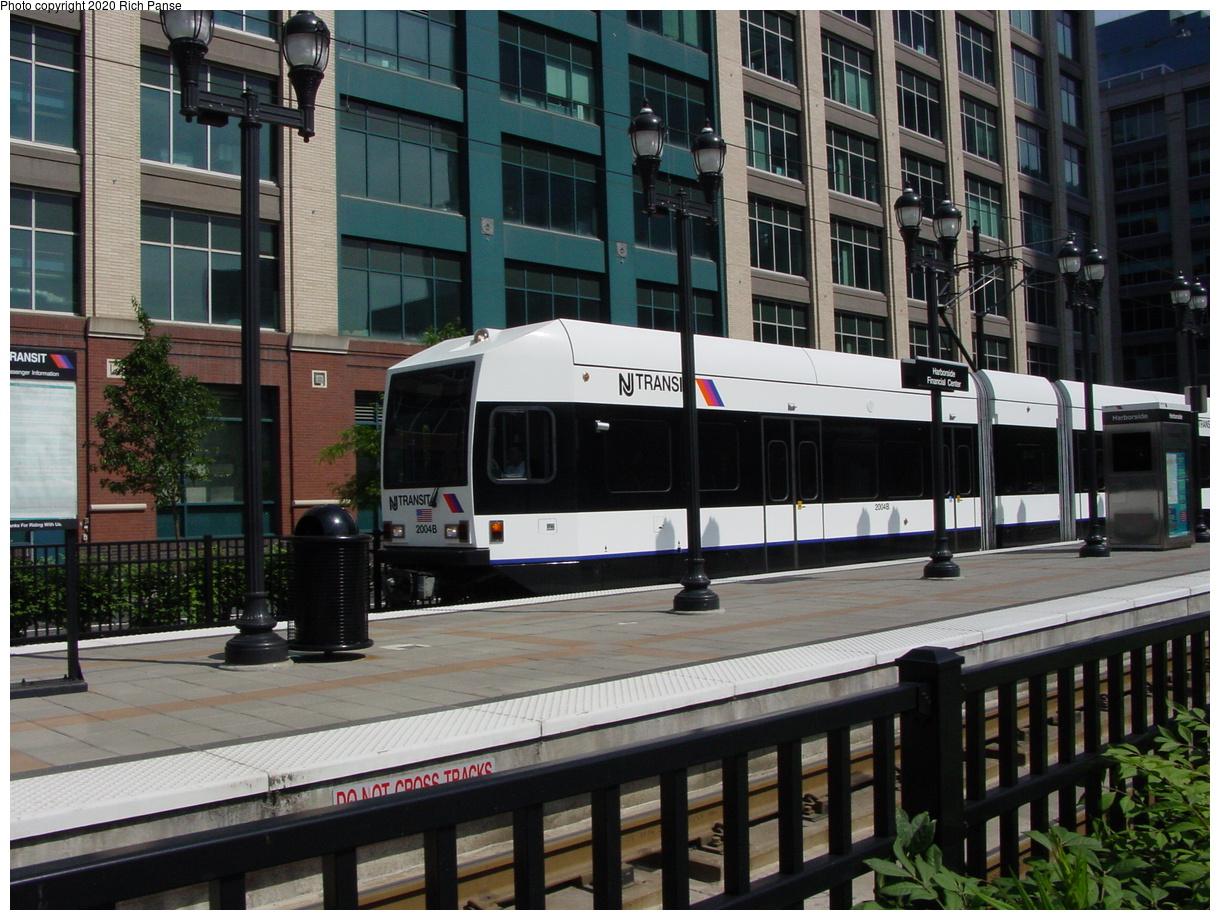 (97k, 820x620)<br><b>Country:</b> United States<br><b>City:</b> Jersey City, NJ<br><b>System:</b> Hudson Bergen Light Rail<br><b>Location:</b> Harborside <br><b>Car:</b> NJT-HBLR LRV (Kinki-Sharyo, 1998-99)  2004 <br><b>Photo by:</b> Richard Panse<br><b>Date:</b> 6/16/2003<br><b>Viewed (this week/total):</b> 0 / 2342
