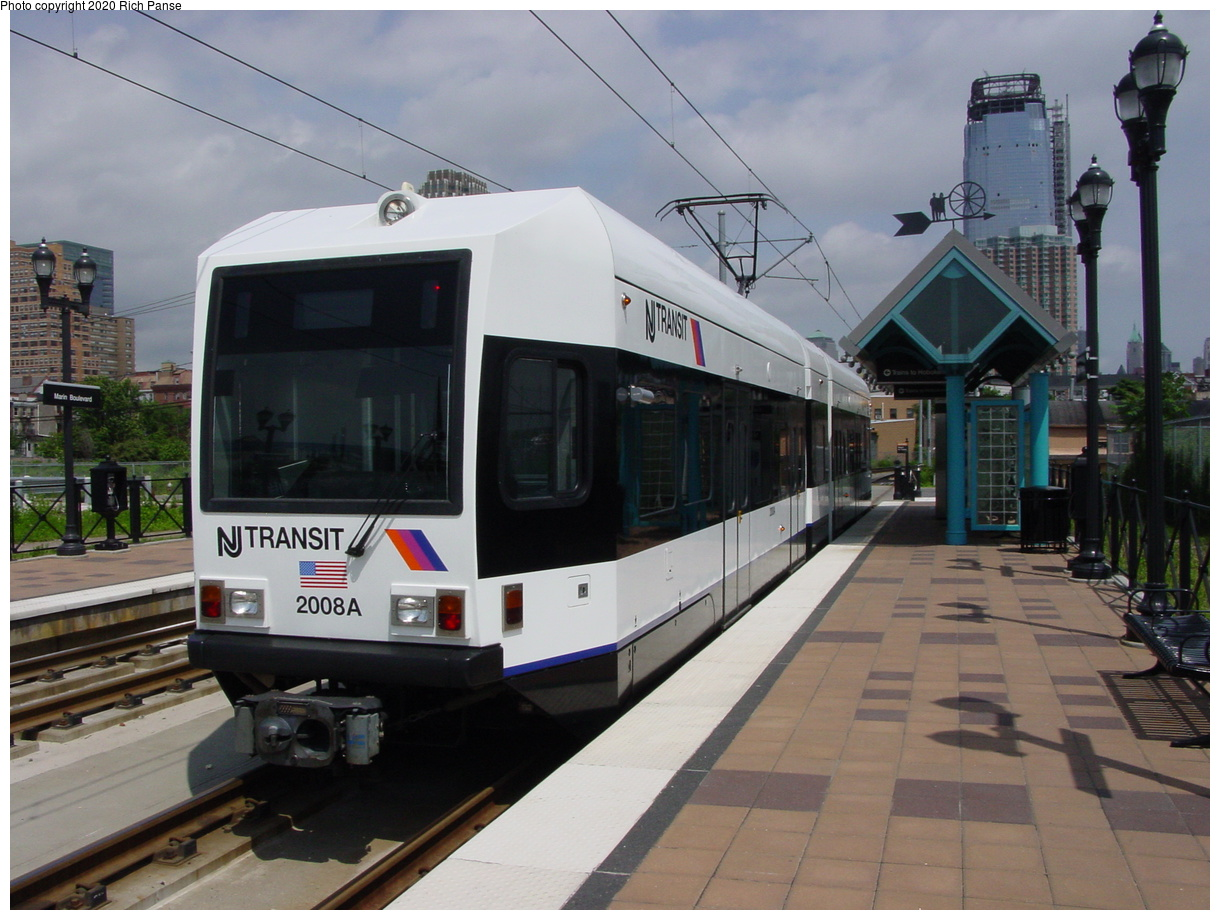 (74k, 820x620)<br><b>Country:</b> United States<br><b>City:</b> Jersey City, NJ<br><b>System:</b> Hudson Bergen Light Rail<br><b>Location:</b> Marin Boulevard <br><b>Car:</b> NJT-HBLR LRV (Kinki-Sharyo, 1998-99)  2008 <br><b>Photo by:</b> Richard Panse<br><b>Date:</b> 6/16/2003<br><b>Viewed (this week/total):</b> 1 / 2750