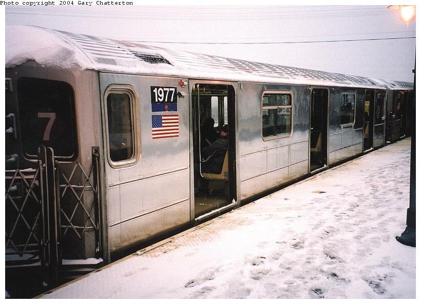 (81k, 820x592)<br><b>Country:</b> United States<br><b>City:</b> New York<br><b>System:</b> New York City Transit<br><b>Line:</b> IRT Flushing Line<br><b>Location:</b> 61st Street/Woodside <br><b>Route:</b> 7<br><b>Car:</b> R-62A (Bombardier, 1984-1987)  1977 <br><b>Photo by:</b> Gary Chatterton<br><b>Date:</b> 12/6/2003<br><b>Viewed (this week/total):</b> 0 / 4004