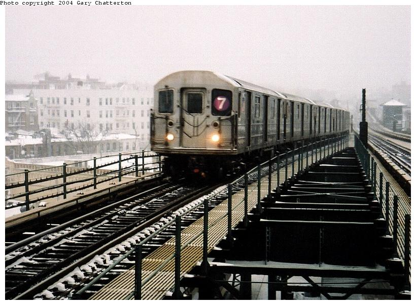 (95k, 820x602)<br><b>Country:</b> United States<br><b>City:</b> New York<br><b>System:</b> New York City Transit<br><b>Line:</b> IRT Flushing Line<br><b>Location:</b> 61st Street/Woodside <br><b>Route:</b> 7<br><b>Car:</b> R-62A (Bombardier, 1984-1987)  1995 <br><b>Photo by:</b> Gary Chatterton<br><b>Date:</b> 12/6/2003<br><b>Viewed (this week/total):</b> 0 / 3727