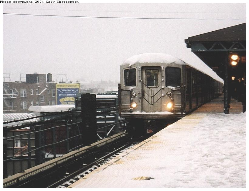 (74k, 820x628)<br><b>Country:</b> United States<br><b>City:</b> New York<br><b>System:</b> New York City Transit<br><b>Line:</b> IRT Flushing Line<br><b>Location:</b> 61st Street/Woodside <br><b>Route:</b> 7<br><b>Car:</b> R-62A (Bombardier, 1984-1987)  2018 <br><b>Photo by:</b> Gary Chatterton<br><b>Date:</b> 12/6/2003<br><b>Viewed (this week/total):</b> 1 / 3421