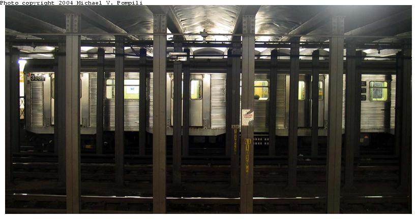 (63k, 820x432)<br><b>Country:</b> United States<br><b>City:</b> New York<br><b>System:</b> New York City Transit<br><b>Line:</b> IND 8th Avenue Line<br><b>Location:</b> 23rd Street <br><b>Route:</b> E<br><b>Car:</b> R-32 (Budd, 1964)  3589 <br><b>Photo by:</b> Michael Pompili<br><b>Date:</b> 12/4/2003<br><b>Viewed (this week/total):</b> 0 / 5995