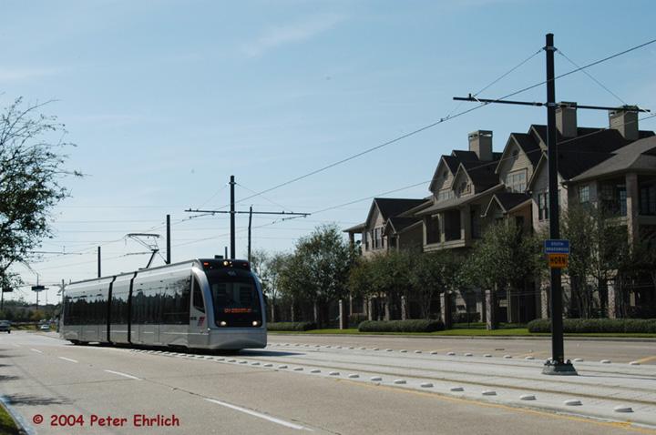 (119k, 720x478)<br><b>Country:</b> United States<br><b>City:</b> Houston, TX<br><b>System:</b> Houston METRORail<br><b>Location:</b> Braeswood & Greenbriar <br><b>Car:</b> Siemens Avanto 105 <br><b>Photo by:</b> Peter Ehrlich<br><b>Date:</b> 2/6/2004<br><b>Notes:</b> A northbound train has just turned onto Braeswood from Greenbriar.<br><b>Viewed (this week/total):</b> 0 / 3934