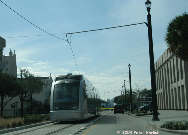 (110k, 720x516)<br><b>Country:</b> United States<br><b>City:</b> Houston, TX<br><b>System:</b> Houston METRORail<br><b>Location:</b> Main & Stuart <br><b>Car:</b> Siemens Avanto 108 <br><b>Photo by:</b> Peter Ehrlich<br><b>Date:</b> 2/6/2004<br><b>Notes:</b> A truck pulled the wires down on the outbound track at Ensemble/HCC Station and car 108 is stranded at Main & Stuart.<br><b>Viewed (this week/total):</b> 1 / 3159